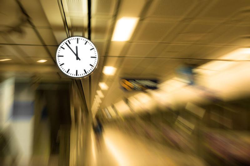 Low Angle View Of Illuminated Clock At Railroad Station