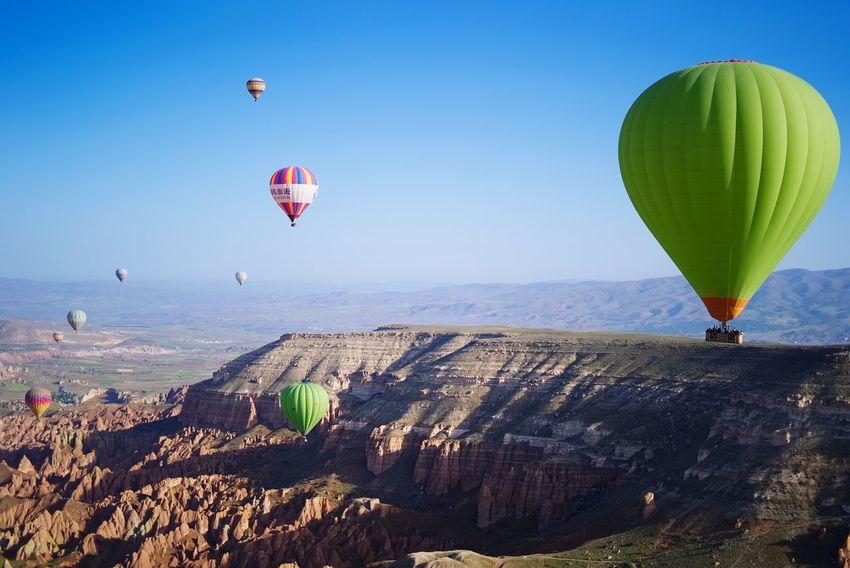 Balloon flight over the valley Valley Cappadocia Kapadokya Turkey Knycl Balloon Hot Air Balloon Air Vehicle Transportation Sky Water Nature Flying Mid-air Day Scenics - Nature Land Travel Outdoors Adventure