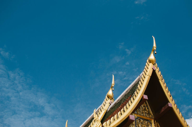Thai Temple roof Architecture Blue Building Built Structure Cloud - Sky Copy Space Day High Section Low Angle View No People Outdoors Place Of Worship Religion Sky Spire  Spirituality Travel Travel Destinations