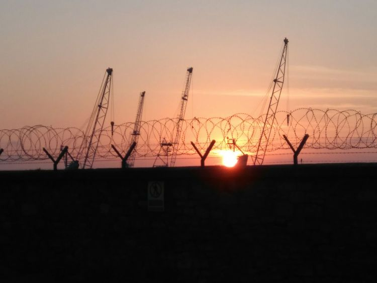 Silhouette Sunset Sun Sky Tranquility Outdoors Scenics Day No People Cranes For Construction Sunsetphotographs