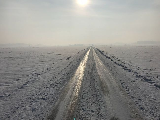 Icy road The Way Forward Diminishing Perspective No People Winter Outdoors Sky Cold Temperature Beauty In Nature Day Road Shades Of Winter