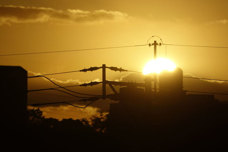 Japan Photos Sunpark Cloudpark Sunset Silhouette Cable Sun No People Outdoors Sky Electricity Pylon Electricity  Scenics Cloud - Sky Dramatic Sky Tranquil Scene Sunlight Tranquility Telephone Line Nature