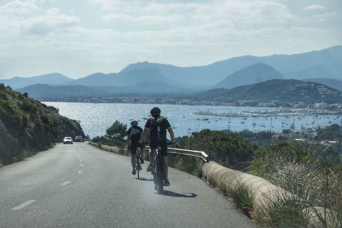 Cap Formentor Mallorca Bay Beauty In Nature Bicycle Cycling Day Mammal Men Mode Of Transport Mountain Mountain Range Nature Outdoors People Real People Rear View Riding Road Scenics Sea Sky Transportation Tree Water