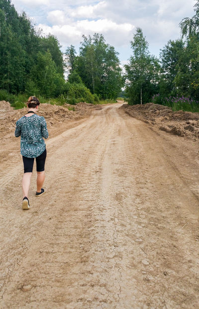 Cloud - Sky One Person Rear View Sky Full Length People Agriculture One Young Woman Only Young Adult Only Women Real People Outdoors One Woman Only Nature Day Tree Walking Dirt Road Russia Rural Scene Road Way Birch Trees WoodLand Summer
