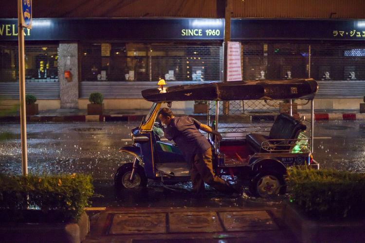 Raining night in Bangkok | Tuk Tuk out of service City Life Lifestyles Men Mode Of Transport Riding Street Transportation Urban