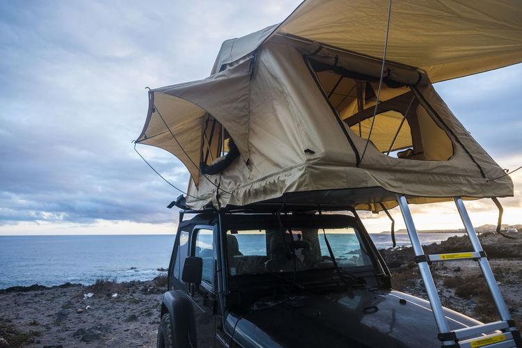 Tent on car against sky
