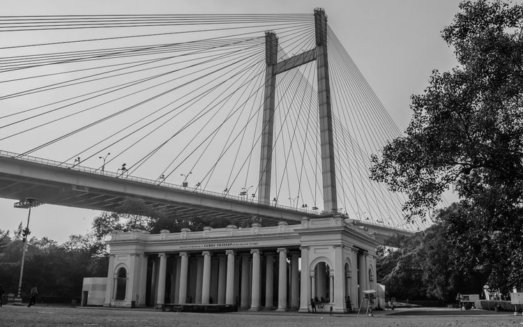 Beauty of Calcutta Architectural Column Architecture Bridge Bridge - Man Made Structure Building Exterior Built Structure Calcutta Riverside City Connection Day James Prinsep Ghat Kolkatacity Kolkatadiaries Low Angle View No People Outdoors Princep Ghat Shvm8961 Sky Transportation Travel Travel Destinations Tree Vidyasagar Setu Vidyasagarsetu