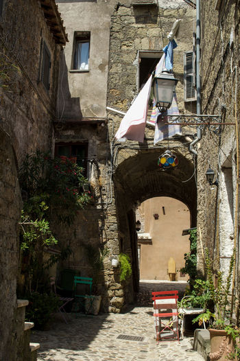 Arch Architecture Building Exterior Calcata Chair Day Hanging Clothes Italy No People Old Houses Outdoors Tourism Town Village