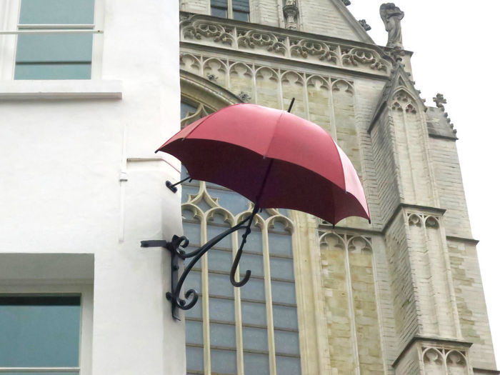 red umbrella Architecture Built Structure Building Exterior Low Angle View Building Day No People Outdoors Red Umbrella Flag City Protection Travel Destinations