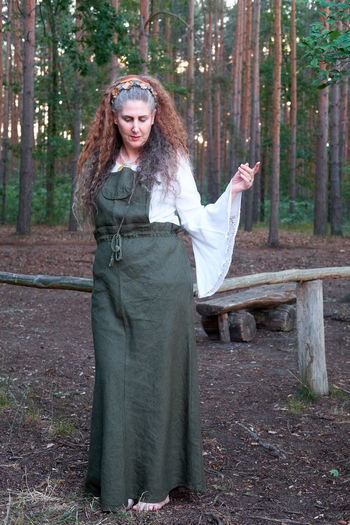 Portrait of woman standing in forest