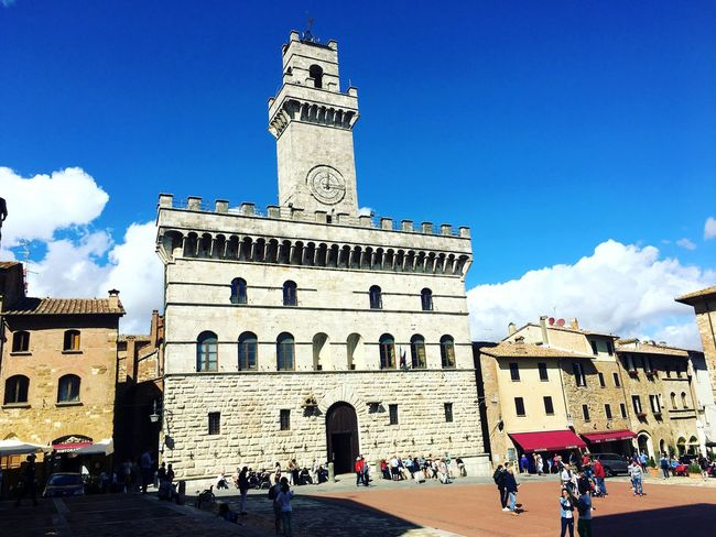 Architecture Large Group Of People Built Structure Building Exterior Sky Blue Real People Travel Destinations Cloud - Sky Day Low Angle View Tourism History Religion Outdoors Women Men Clock Tower Sunlight Place Of Worship Tuscany Countryside Tuscany Montepulciano Piazza Grande