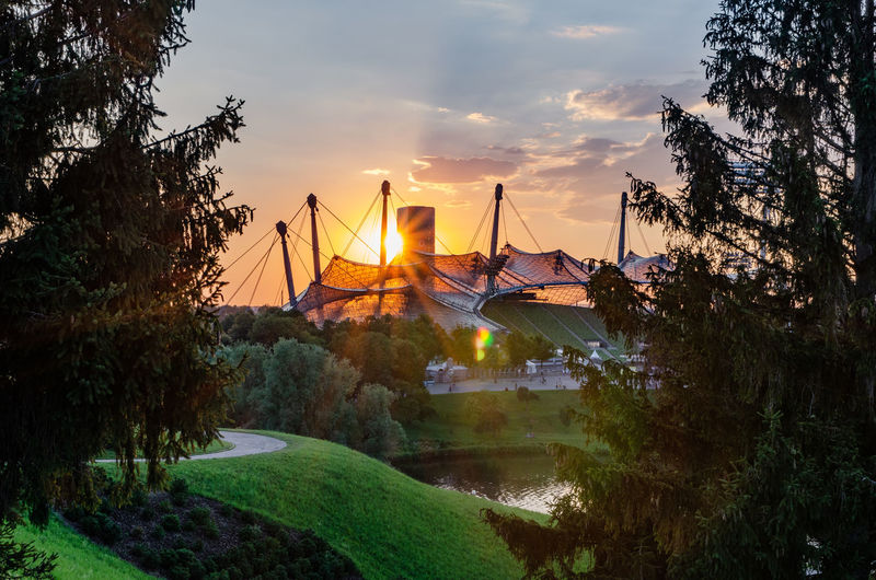 Munich Olympic Park Bavaria Cityscape Framed Munich Olympic Park  Olympic Stadium Sun Star Sunlight Tranquility Architecture Cloud - Sky Frame Germany Nature No People Olympiapark Olympiastadium Outdoors Sky Sunset Tree Water
