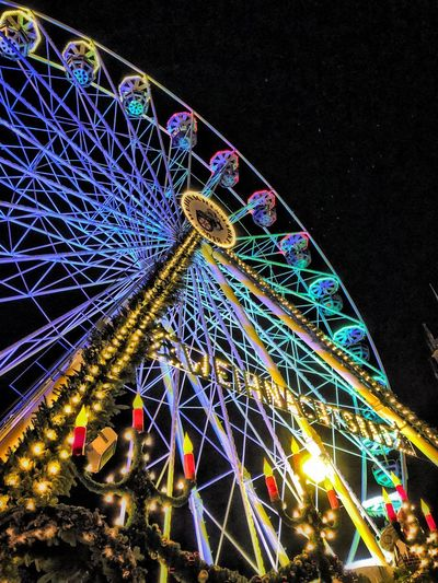 Riesenrad Ferris Wheel Amusement Park Ride Amusement Park Illuminated Low Angle View Night Architecture Built Structure Arts Culture And Entertainment Sky Multi Colored No People City Lighting Equipment Traveling Carnival Nature Carnival Fairground Outdoors Travel Destinations