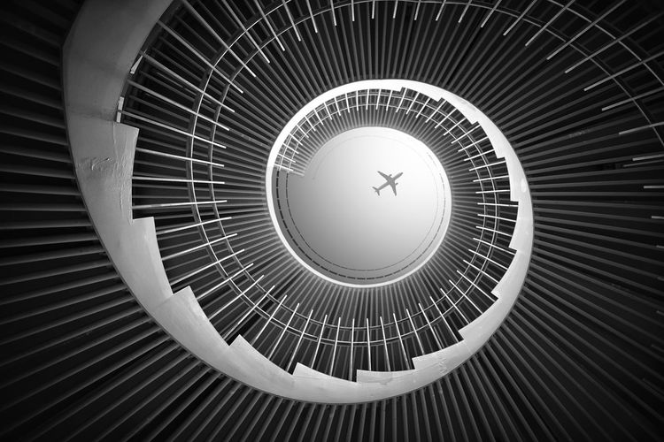 Low angle view of spiral staircase in building against skylight