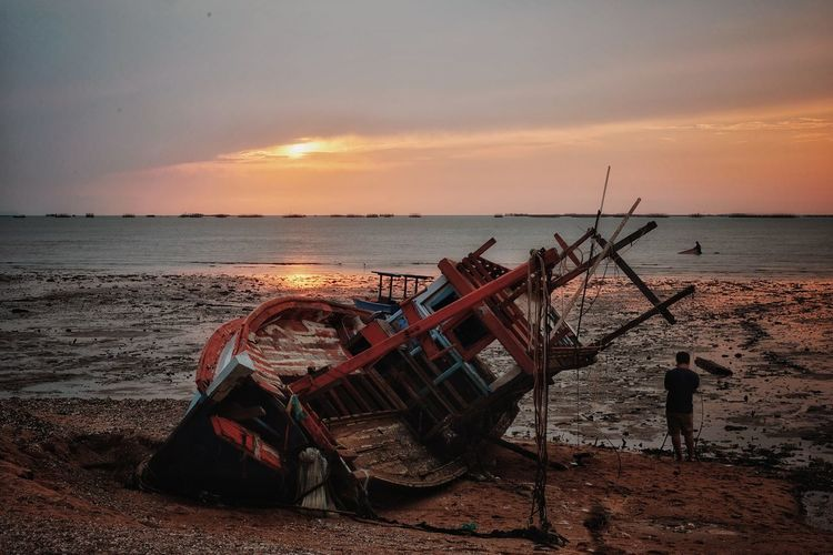 evening time Water Nautical Vessel Sea Sunset Beach Sand Low Tide Reflection Fishing Industry Sky Moored Boat Seascape