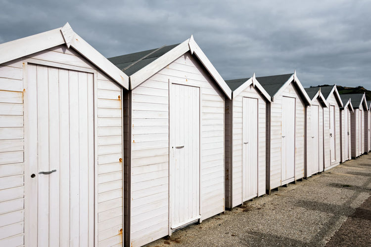 Beach Huts Beach Hut Hut Side By Side In A Row Beach Summertime Summery Holiday Vacations Sunny Beach Huts Holidays Vacation Tourism Pink Color Pink Light Pink Shed Summer Relax Travel Architecture Concept Conceptual Background