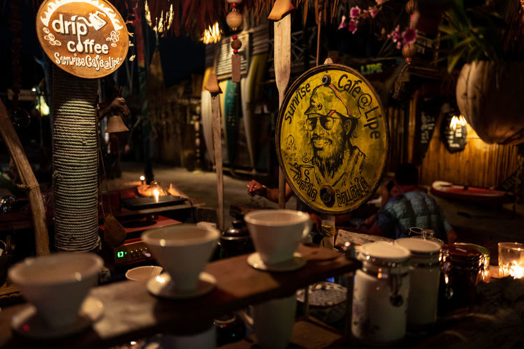 Koh Lipe Lighting Equipment No People Hanging Large Group Of Objects Indoors  Illuminated Close-up Business Market Selective Focus Variation Choice Text Cup Script Antique Night Drink Art And Craft Non-western Script Electric Lamp Tea Cup