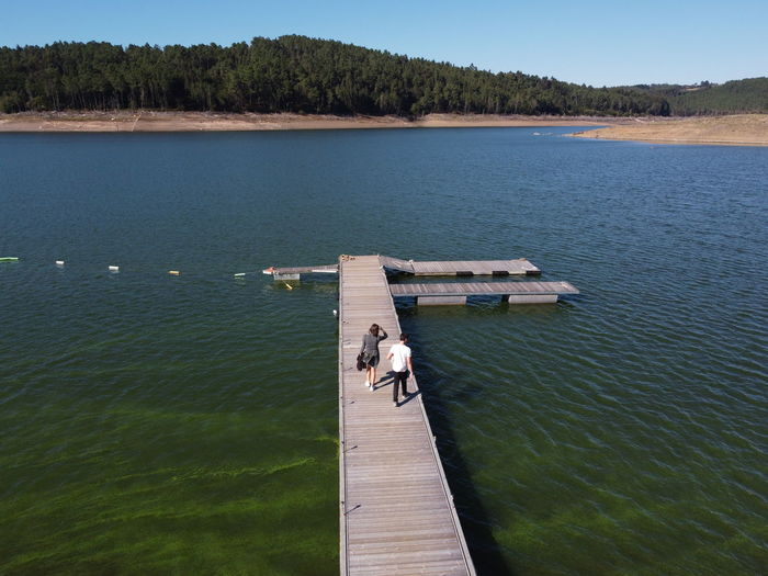 High angle view of pier amidst lake