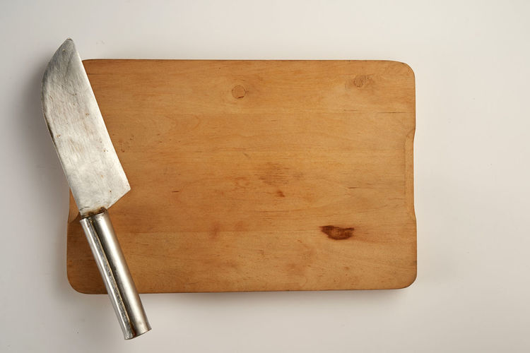High angle view of bread on table against white background