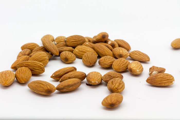 Almonds Abundance Almond Brown Close-up Food Group Of Objects Heap Isolated Large Group Of Objects No People Nuts Shelled Shelled Nuts Snack Still Life Studio Shot White Background