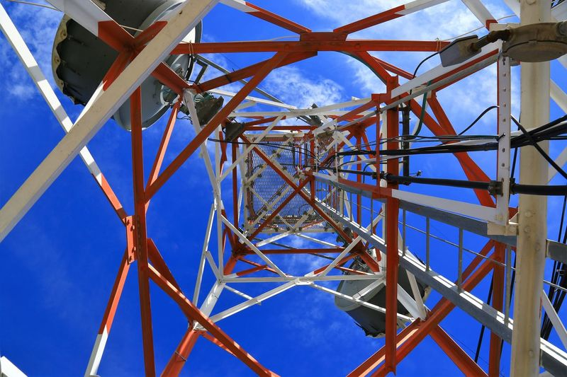 Directly Below Shot Of Communications Tower Against Sky