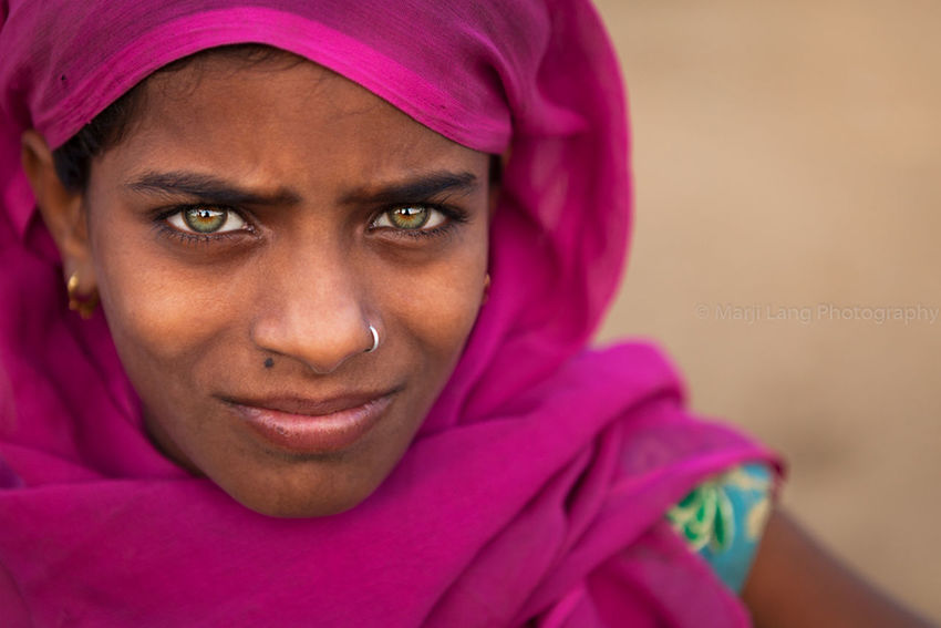Muskan, a green eyed young girl from Rajasthan, India. Beautiful Girl Beauty Close-up Cute Documentary Portrait Girl Girl Child Green Eyed Girl Green Eyes Headshot Human Face India Indian Indiana Intense Lovely Person Pink Color Portrait Pushkar Rajasthan Girl Power Scarf Travel Travel Photography
