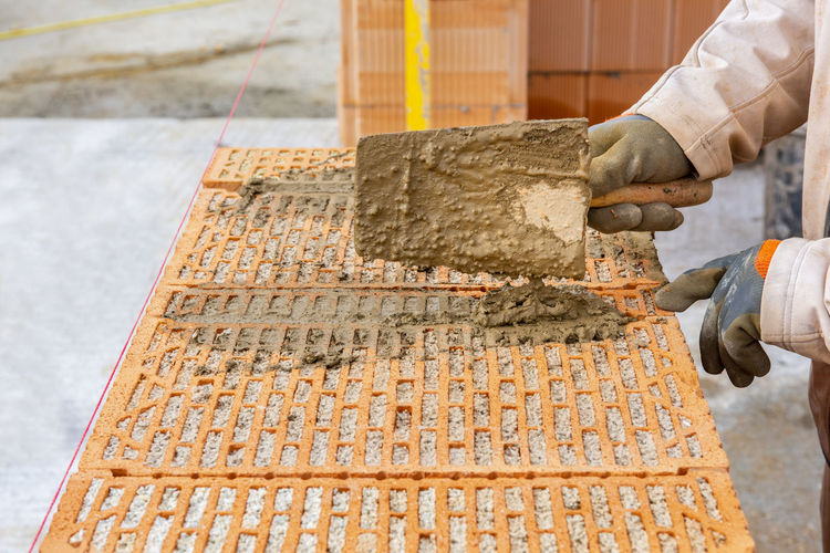 Low angle view of man working against built structure