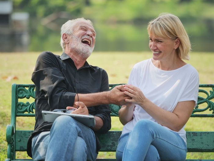 Sitting Two People Men Males  Three Quarter Length Adult Togetherness Bonding Casual Clothing Real People Smiling Seat Leisure Activity Senior Adult Lifestyles Emotion Women Couple - Relationship Happiness Mature Adult Mature Men Positive Emotion Outdoors Park Bench