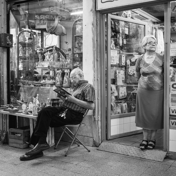 Shop owners keeping an eye out for street photographers. For Sale Indoors  Man Market Read Seniors Shopkeeper Standing Storefront Woman