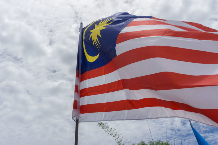 Malaysia Flag waving in the air - Malaysia National Day Concept 31ogos Celebration Colourful Freedom Patriotic Patriotism Sky And Clouds Standing Countryside Day Festival Flag Independence Day Low Angle View Malaysia Merdeka57 Nation No People Outdoors Patriotism Sky Striped