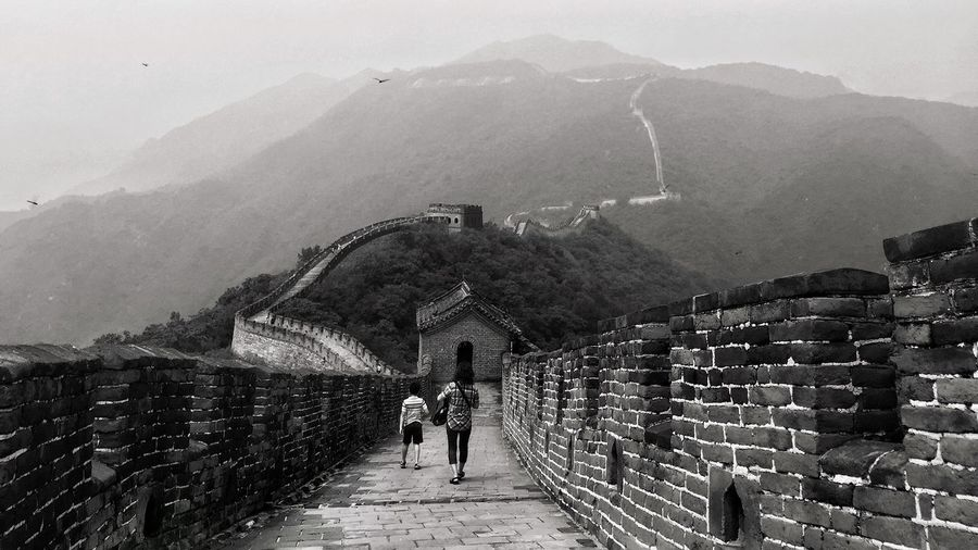 PEOPLE WALKING ON THE GREAT WALL OF CHINA