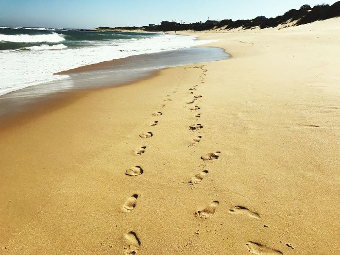Sea Beach Water Nature Sky Holiday Blue Blue Sky Day Outdoors Tranquility Footsteps Sand Waves Shore Scenics Beauty In Nature Port Alfred Tranquil Scene