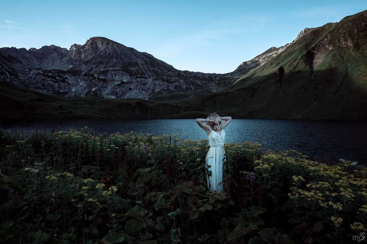 Woman in Landscape Blue Hour Schrecksee White Dress Woman Beauty In Nature Idyllic Lake Mountain Mountain Range Nature Outdoors Plant Scenics - Nature Sunrise Tranquil Scene Tranquility Vintage Water