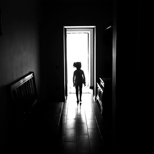 IPS2016Composition IPhoneography Mobilephotography Blackandwhite Silhouette IPS2016People Child Children Only Day Door Entrance Flooring Full Length Home Interior One Person One Girl Only The Way Forward Sunlight Rear View Standing Monochrome Photography Black And White Friday