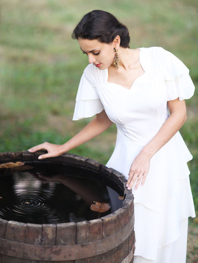 Young woman looking in water