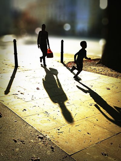 Run from the sun Shadow Sunlight Focus On Foreground Boys Lifestyles Incidental People Focus On Shadow Day Outdoors Person Silhouette