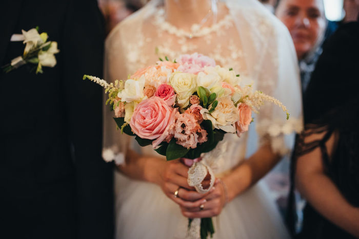 Bonding Bouquet Bouquet Of Flowers Bride Bridegroom Celebration Celebration Event Ceremony Flower Focus On Foreground Groom Holding Human Body Part Human Hand Indoors  Life Events Love Men Midsection Real People Togetherness Wedding Wedding Ceremony Wedding Dress Women