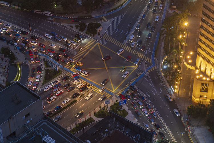 High angle view of cars on road in city at night