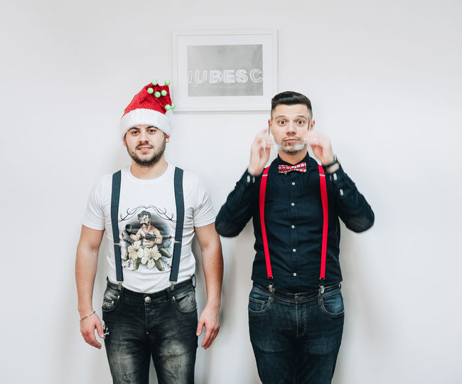 Spot the boss. Christmas Spirit Office Christmas Party Two People Adults Only Adult Humor Front View Portrait Fun People Beard Looking At Camera Friendship Individuality Togetherness Men Only Men Indoors  Red