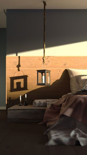 Illuminated electric lights hanging on bed by window