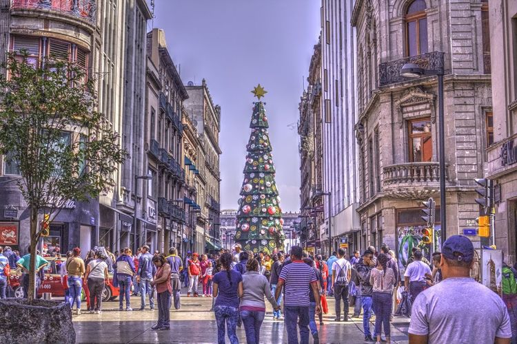 Allende Street in the down town of mexico city, in december there is a christmas tree in the zocalo Adult Architecture Building Exterior Built Structure Chirstmas Tree City Cmdx Day Large Group Of People Lifestyles Men Mexico City Outdoors People Real People Sky Travel Destinations Tree Walking Women The Street Photographer - 2017 EyeEm Awards