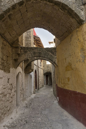 Traditional street of old town, Rhodes, Greece Architecture Old Town Streets Rhodes Greece Ancient Buildings Arch Built Structure Byzantine Influenze Cobbled Street Day History No People Old Town, Rhodes Outdoors