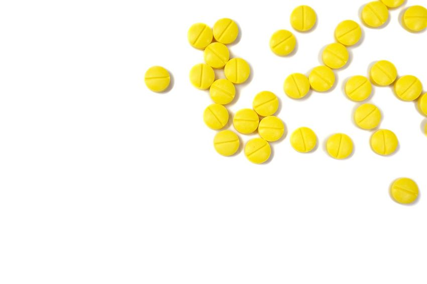 Yellow pills on white background White Background Yellow Studio Shot Cut Out Healthy Eating No People Nutritional Supplement Food Close-up Medical Phamaceutical Pharmacy Sick