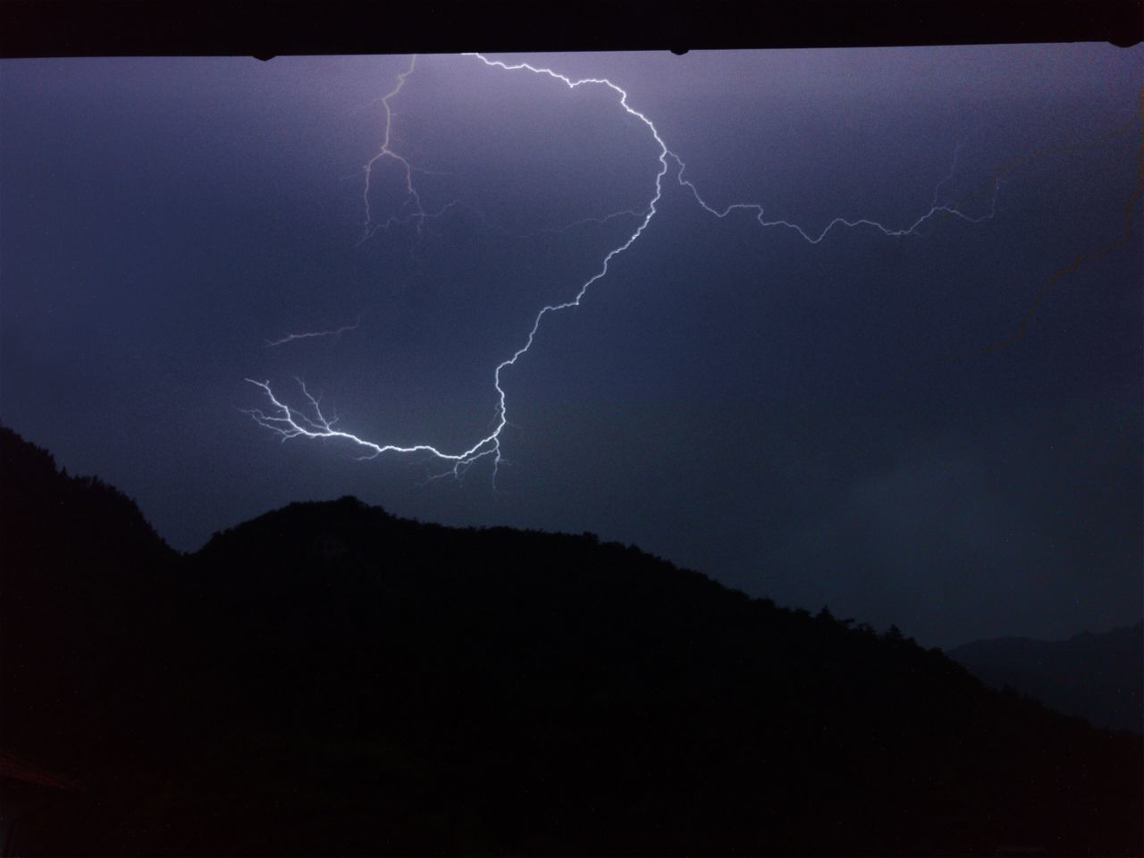 lightning, storm, power in nature, cloud - sky, beauty in nature, thunderstorm, power, sky, night, forked lightning, nature, dramatic sky, mountain, sign, environment, silhouette, scenics - nature, no people, warning sign, outdoors, extreme weather, light