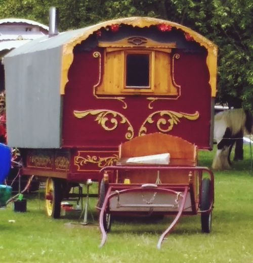 Traditional Gypsy Caravan Traditional Horse-drawn Gypsy Caravan Grass Seat Plant Day No People Nature Field Green Color Outdoors Old Park Wood - Material