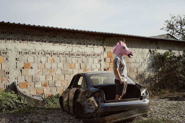Unicorn Unicorn Head Scrapyard Scrap Car Full Length Summer Standing Men Sky Vintage Car #urbanana: The Urban Playground 2018 In One Photograph