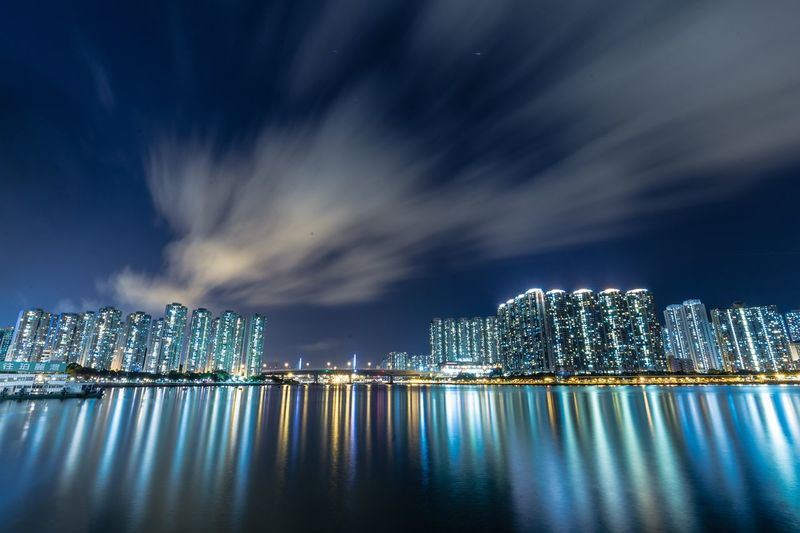 Buildings with sea reflection at night
