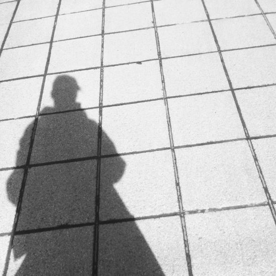 Real People Shadow Focus On Shadow One Person Lifestyles Sunlight Pattern Men Tiles Tiles Architecture Tiles Textures Day Outdoors