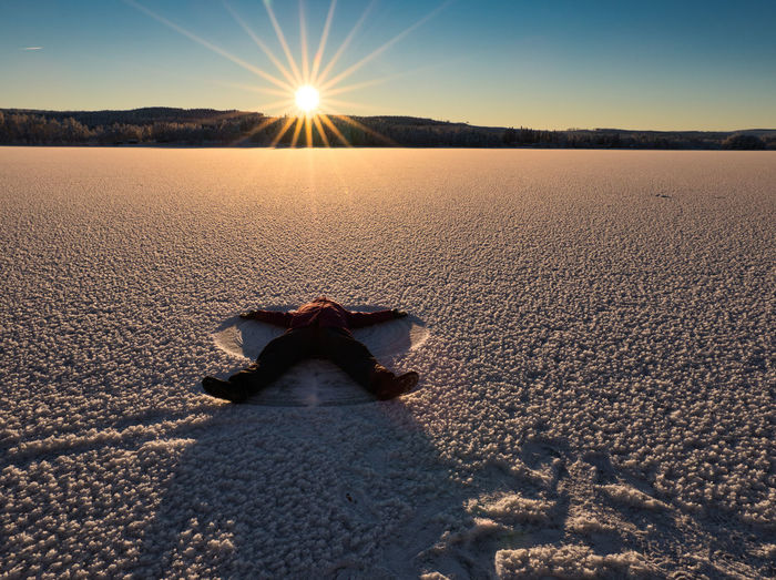 Happy to be me Happy Snow Angel Frost Frozen River Sun Sun Light Sunset Nature person Alone Sky Beauty In Nature Tranquil Scene Horizon Tranquility Horizon Over Land Idyllic Outdoors Surface Level Climate Lens Flare Day Winter Wintery