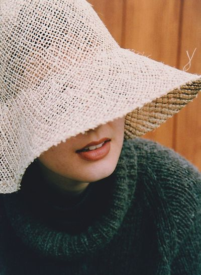 Close-up of woman wearing straw hat